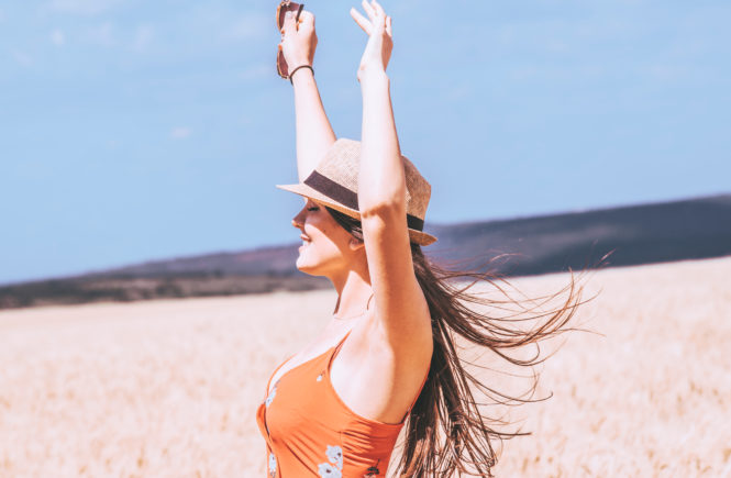 Canva - Photo of Woman Raising Her Both Arms
