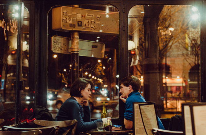 Canva - Selective Focus Photography of Man and Woman Sitting on Chair Inside Restaurant during Nighttime (1)